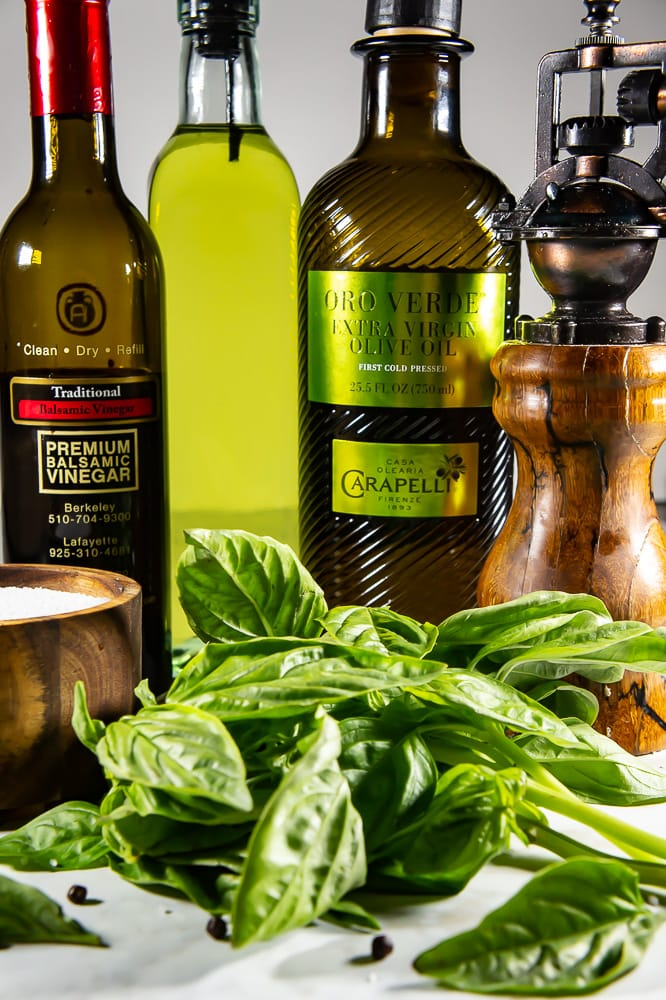The ingredients for a Basil Balsamic Vinaigrette are easy: Vinegar, basil, salt, pepper, olive oil, and canola oil.