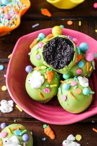 chocolate cake pops coated in green candy melts with easter sprinkles