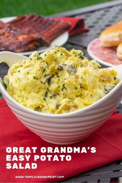 A bowl of potato salad with ribs and hot dogs