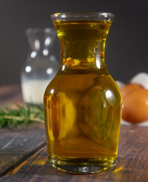 a glass carafe of olive oil