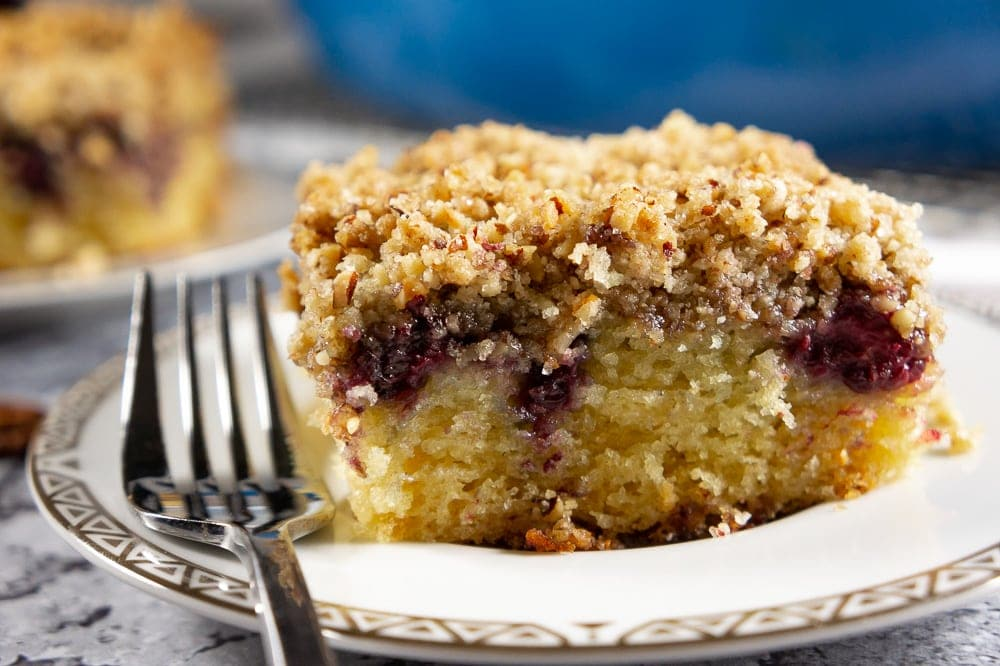 A slice of pecan blackberry coffee cake