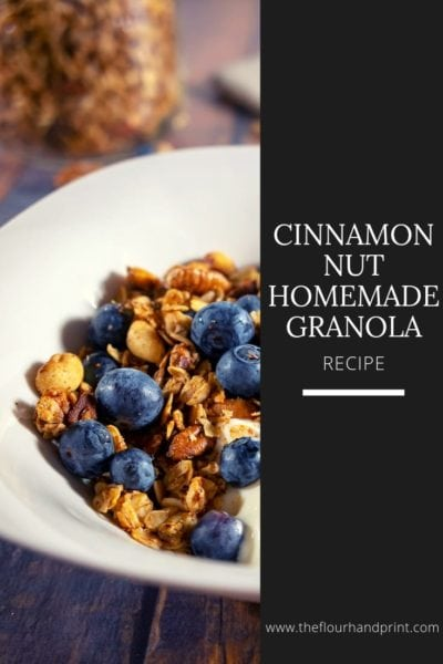A bowl of homemade granola with yogurt and blueberries