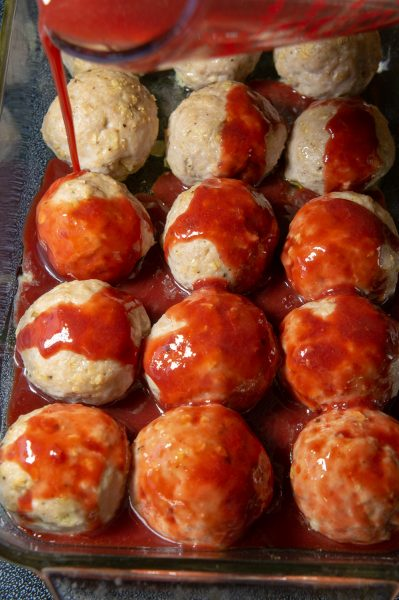 Pouring glaze over the meatballs